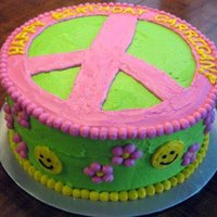 Peace, Love, & Tie Dye Vanilla and Strawberry tie dye cake decorated with buttercream