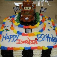 Cars Tow-Mater Birthday Cake Chochlate Cake with traditional buttercream icing made with heavy cream. All decorating done with buttercream icing. Wilton Star Sprinkles...