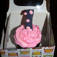 Smash Cupcake A smash cupcake for a 1yr old. Made the 1 out of fondant which I inserted a toothpick in before harding in the freezer so It would stand...