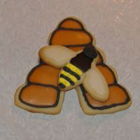 Bee And Beehive This is a cookie I did for a display cookie for where I work. It is two separate cookies that are glued together with royal icing. They are...