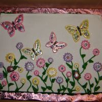 White Chocolate Butterfly This was done for a baby shower where my husband works. The flowers and butterflies are white chocolate dusted with super pearl.