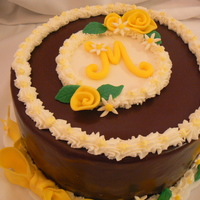 Mindy's Ganache With Roses And Daisies  This cake was yummy! It's dark chocolate fudge cake with a filling of one layer of cream cheese and another layer of chocolate pecan...