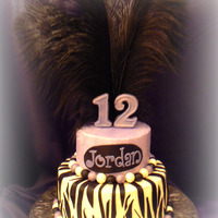 "Jordan's Zebra/feather Cake This is my daughter's 12th birthday cake. The bottom zebra tier is a 9"" lemon and the top tier is a 6"" chocolate. Both have..."