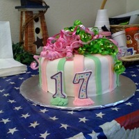 Birthday Bows White cake covered in MMF with cut stripes of MMF for accents, the actual bows on top were real. I tried to make a MMF bow and it was a...