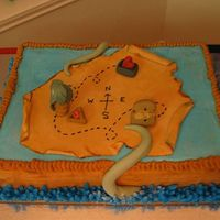 Pirates Of The Caribbean  This was for a Pirates of the Caribbean themed party. The treasure map has a symbol from each movie. The sides of the cake are made to look...
