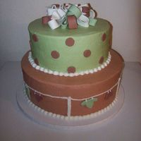 Neutral Clothesline Cake Top tier is white cake with Raspberry filling, bottom tier is a mexican chocolate cake with cinnamon mouse filling.All covered in...