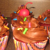 Cupcakes Some cupcakes I did to go along with a Dora cake. Cherry and sprinkles scuplted out of fondant.