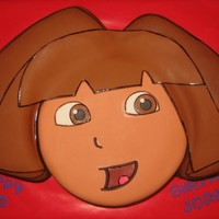 Dora The Explorer Dora cake I made for my neice. Peanut butter cake with chocolate buttercream covered in fondant. One of 2 cakes I am making this weekend......
