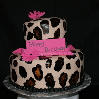 Leopard Cake  red velvet cake used a recipe from on here, raspberry buttercream...yummy!I had made a loop bow topper but had problems and left it off. Wa...