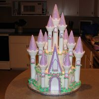 Daughter's First Birthday Cake my first castle cake. I thought it went pretty good. filled and iced in buttercream, the flowers are fondant.