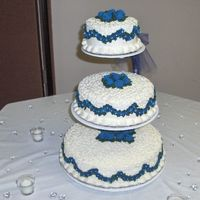 My Wedding Cake This was my first wedding cake and also the cake for my wedding. I used royal icing for the flowers and just a simple buttercream for the...