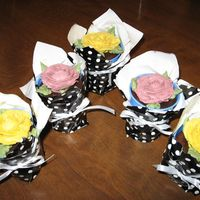 Cupcake Plant made these cup cakes with a rose.put in papercup and covered with wrapping paper to look like a plant.