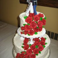 Red Rose Wedding Cake roses are fondant, cake is buttercream