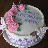 Pink Roses, Purple Butterflies roses and icing are buttercream. butterflies are white chocolate candy