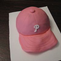 Pink Phillies Cap cap is covered with fondant. made this for a friend who has breast cancer