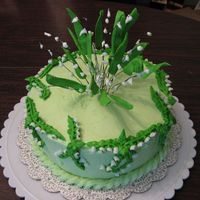 Lilies Of The Valley center flowers are royal icing on floral wire. cake is buttercream