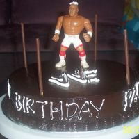 All Chocolate Cake Made this for my dad's 75th Birthday. He loves wrestling so much that gave me the idea for this cake. Chocolate sponge with chocolate...
