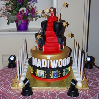Madiwood! Hollywood Themed cake for Madison, topsy tiers with a red carpet, little girl scuplted from gumpaste, theater posters surrounding bottom...