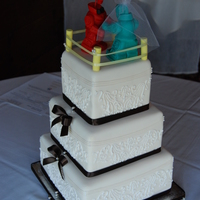 Rock Em Sock Em Wedding! Robots made from fondant, piped pattern on cake matches invitation. Fun couple!