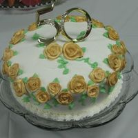 50Th Anniversary-White W/ Gold Roses This is very similar to the other 50th anniversary cake I did. This one has roses colored with gold luster dust, green vines and leaves,...