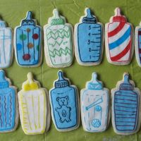 Baby Bottle Cookies Subaru's cream cheese sugar cookie recipe covered with MMF and decorated with food markers.
