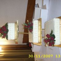 119654915298624.jpg this is my second wedding cake. the theme was creme and gold.the cake is iced in buttercream.