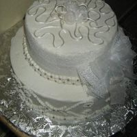 Img_0206_Olga.jpg Almond Cake, sugarshack buttercream with ribbon flowers and lace, need lot of practice to made all in sugar