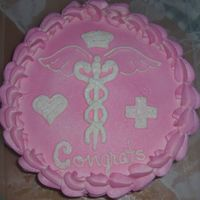 Nursing School Cake did this cake in a hurry. All bc icing air brushed in pink....free handed the medical symbal and nurse hat.