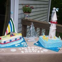 Baby_Shower.jpg  Baby Shower Nautical Cake. Sail boat covered in fondant. Square cake covered in butter cream. Light house made out of pastillage. Details...