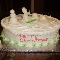 Ski Bear This cake was lots of fun. It was my 1st time sculpting. The bear, skis, snowmen & snowballs are all fondant.