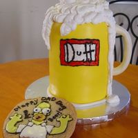 "Duff Beer My first ""perfect"" cake! Yeay! Nothing I was unhappy with, and no ""backside"" to the cake. Dark Chocolate cake with pb..."
