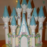 Castle.jpg Here's my beautiful castle before transport. Funfetti cake with BC, and MMF flowers. I was very dissapointed in the Wilton Set. The...