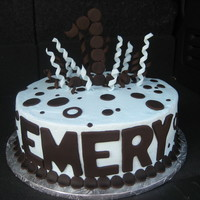 Emery's Cake This cake was covered in buttercream with fondant accents