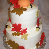 Fall Cake This was a cake made for my elementary school's Fall Festival. Cake is covered in buttercream with fondant accents.