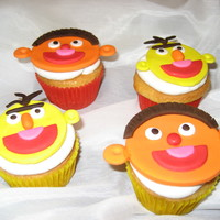 Bert & Ernie Cupcakes   This was for a birthday party for twin boys. French Vanilla cupcakes with buttercream icing. The faces were made out of fondant.