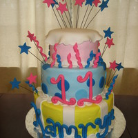 Kamryn's Cake This was my first attempt at a three tier cake. All cakes were covered in buttercream and fondant accents were used.