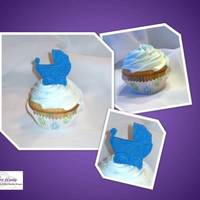 Baby Carriage Cupcakes These were cupcakes for a baby shower. The carriages were made out of fondant by using a mold.