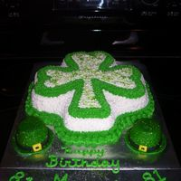 St Paddy's Birthday Girl Did this cake tonight for 81st birthday lady. Dark Chocolate/fudge cake baked in shamrock pan covered in buttercreme stars (tip 16) w/green...