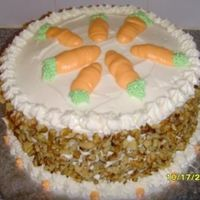 "Walnut Carrot Cake 8"" round with cream cheese icing and walnuts."