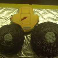 Monster Truck monster truck cake, we carved the shape, used a gummy candy and rolled it out then cut it in the shape of lightning. We had halloween...