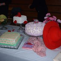 Red Hat Cake got so tired of black over the hill cakes. This picture is of cakes we presented at an expo, but we enjoy doing the red hat cakes for...