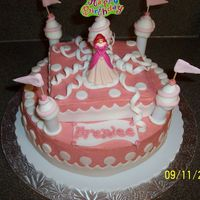 Princess Castle Princess castle cake made with buttercream and fondant accents.