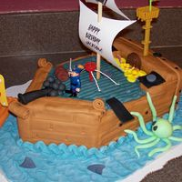Pirate Ship A pirate ship cake for a 4 year old boy's birthday. White cake with fondant and buttercream.
