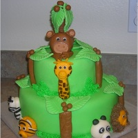 Jungle Baby Shower I made this cake for a girl baby shower. The mom-to-be wanted to do something that had nothing to do with pink, and she also wanted green...