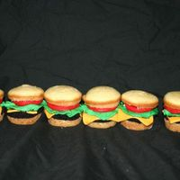 "Hamburger Cupcakes My attempt. I used fondant for all the ""works"" on the burger. Ad the bun and meat are cake. For the meat I just made a square..."