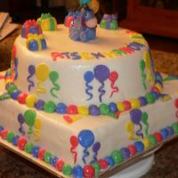 Cake_13_14_025.jpg  this is from the wiltons book. it was for a babys first birthday party. bc icing with mmf, top is vanilla with lemon curd filling and the...