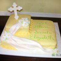Sarah's Baptism Cake WASC with buttercream icing. Daisies are Royal Icing and the drape is fondant. The cross I cut out of a fondant and gumpaste mix from...