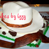 Yee-Haw And Happy Birthday! red velvet cake for the hat and sheet cake it is sitting on. all buttercream on the sheet cake and fonderific buttercream flavored fondant...