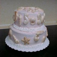 Shells This is a two tier shell cake made for my sister-in-laws 45th wedding anniversary. It is a chocolate fudge cake with chocolate mocha...