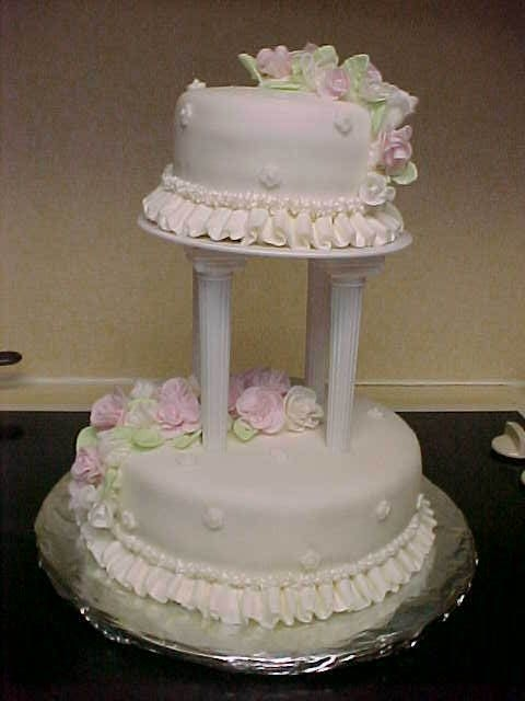 Class Iii Final Cake I made white and light pink roses for my final cake. Our instructor let us have the option of color scheme as long as the cake was white....